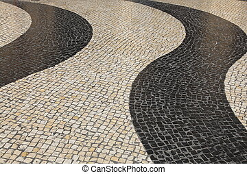 The iconic striped cobblestones of Largo de Senado (The...