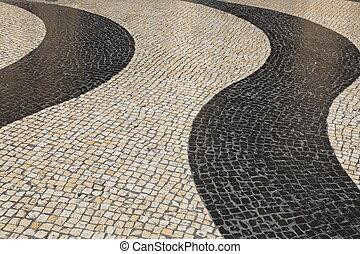 The iconic striped cobblestones of Largo de Senado (The...