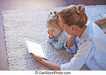 E-learning - Young woman using touchpad for teaching her...