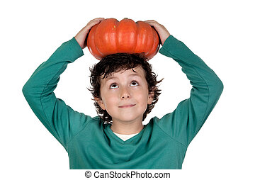 Beautiful little boy with a big pumpkin on a over white...