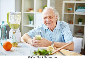 Healthy senior man - Senior man with glass of fruit smoothie...