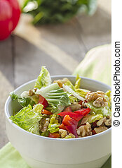 Salad in Bowl - Green Salad with Red Pepper and walnuts in a...