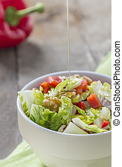 Salad with oil in Bowl - Oil pouring on a bowl with Green...