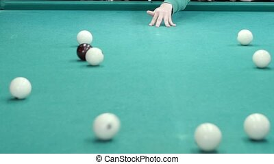 friends gathered for a game of billiards Slow motion -...