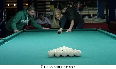 friends gathered for a game of billiards. Slow motion