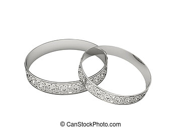 Silver or platinum wedding rings with magic tracery isolated...