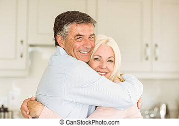Happy mature couple smiling