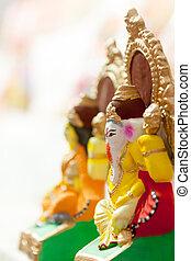 Lord Ganesha and Godess Lakshmi - Close up of colorful and...