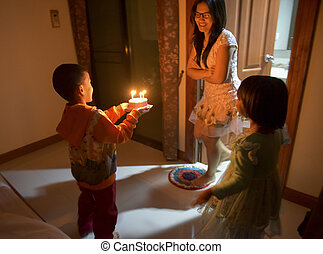 Son, daughter, preparing, surprise, for, mother's, birthday