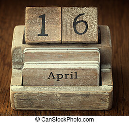 A very old wooden vintage calendar showing the date 16th...