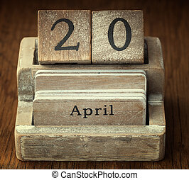 A very old wooden vintage calendar showing the date 20th...