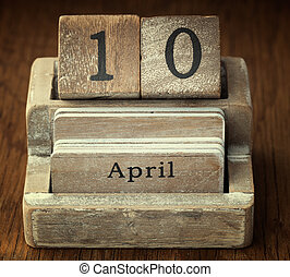A very old wooden vintage calendar showing the date 10th April o