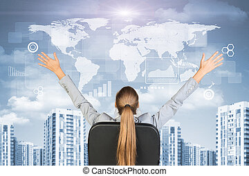 Businesswoman sitting with her hands outstretched against...