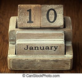 A very old wooden vintage calendar showing the date 10th January