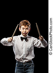 Kick drum sticks - Red-haired boy in a shirt on a black...