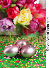 Pink easter eggs with flowers on green fabric
