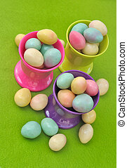 easter eggs in egg cups - egg cups filled with small Easter...