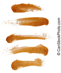 Strokes of golden nail polish isolated on white background