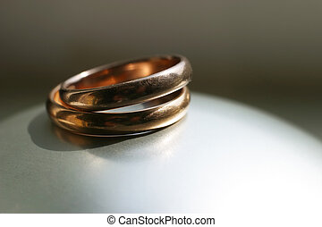 Wedding rings - Two gold wedding rings on a grey background