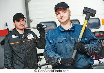 two auto mechanic repairmans