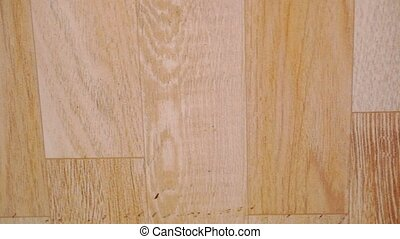 Close up of oak parquet Of beige color. Macro video shift...
