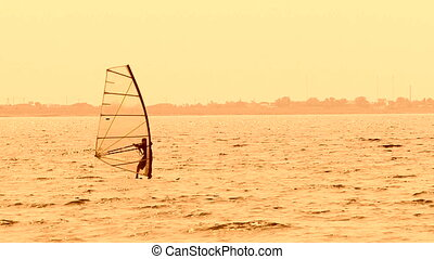 Windsurfer Slowly Sailing in the Black Sea - Camera is...