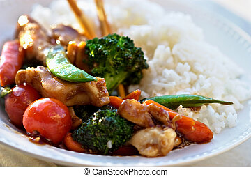 Stir Fried vegetables and chicken with rice Selective focus...