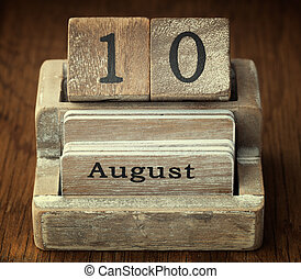 A very old wooden vintage calendar showing the date 10th August