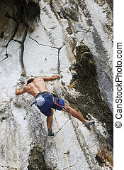 Bouldering - Young man bouldering in Montalban, Philippines