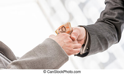 Businessman with Money Handshaking with Partner