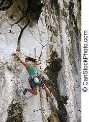 Bouldering - Young woman bouldering in Montalban,...