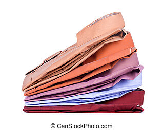 Stacks of many colored clothes isolated on a white...