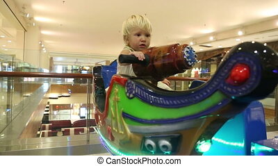 little blonde child sit in toy boat - little blonde child...