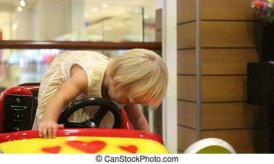 little blonde child rejoice in toy car - little blonde child...