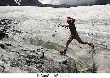 jumping girl across the ice crack in glacier - jumping girl...