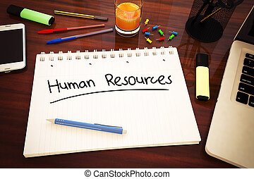 Human Resources - handwritten text in a notebook on a desk -...