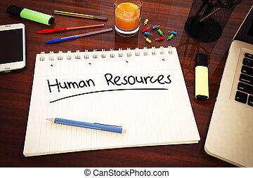 Human Resources - handwritten text in a notebook on a desk -...