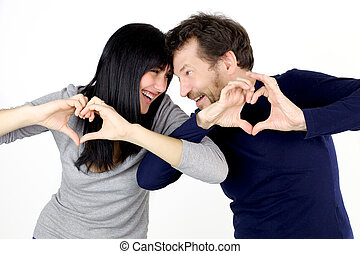 Beautiful couple playing with love sign - Handsome young...