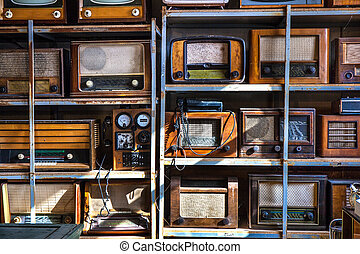 Old Radios on a Shelfs - Old retro radios arranged on an...