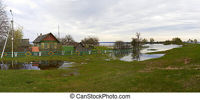 Spring panorama with the river in flood cloudy day Belarus