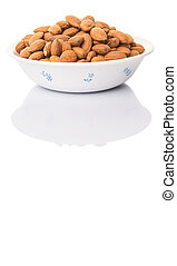 Raw Almond Nut In A White Bowl - Raw almond nut in a white...