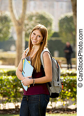 young attractive student girl in university campus green...