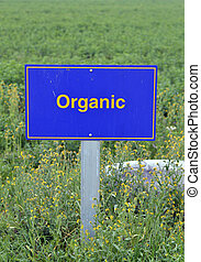 Organic Food. - Organic food label on the pole on the field.