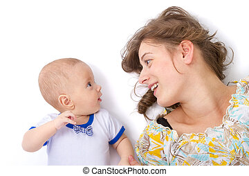 mother talks with her baby boy on white background