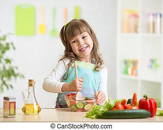 kid girl preparing healthy food