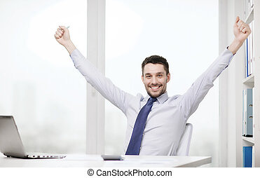 smiling businessman with laptop and documents - office,...