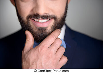Close up of smiling man with beard - Close up photo of...