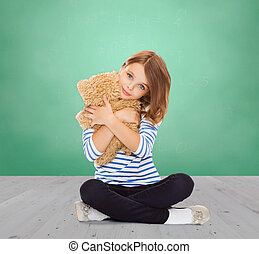 cute little girl hugging teddy bear - childhood, school,...