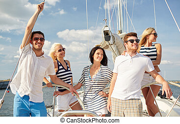smiling friends sailing on yacht - vacation, travel, sea,...