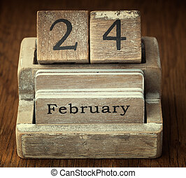 A very old wooden vintage calendar showing the date 24th...
